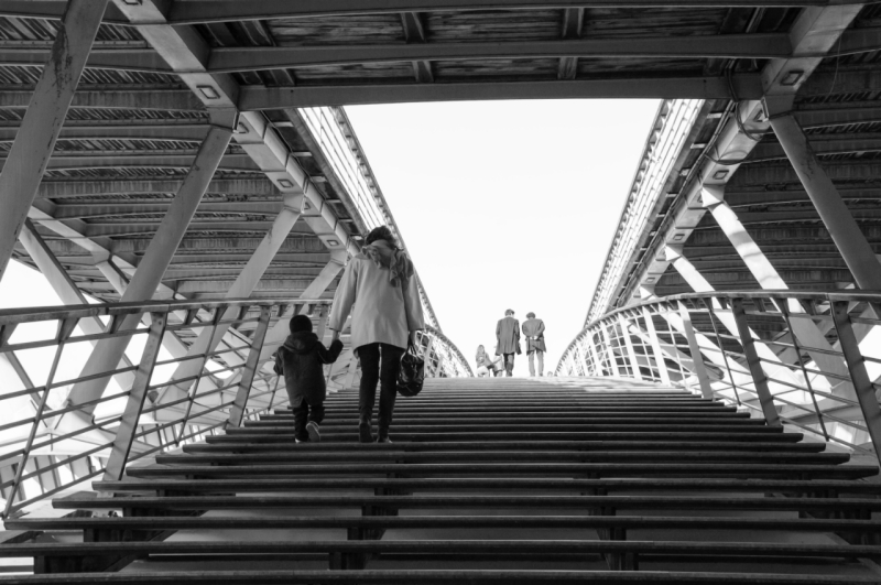 People on pedestrian Solferino bridge over Seine River near Orsey's Museum. Paris, France. Back view.; Shutterstock ID 397923226; Purchase Order: 162858; Job: GMKT_WEB_1.1.1E; Client/Licensee: JLL; Other: