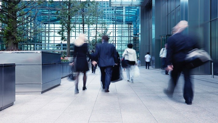 Corporate employees moving towards office in office building