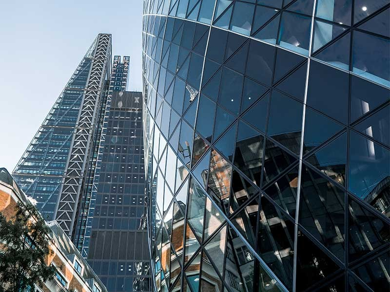 Upward view of glass buildings