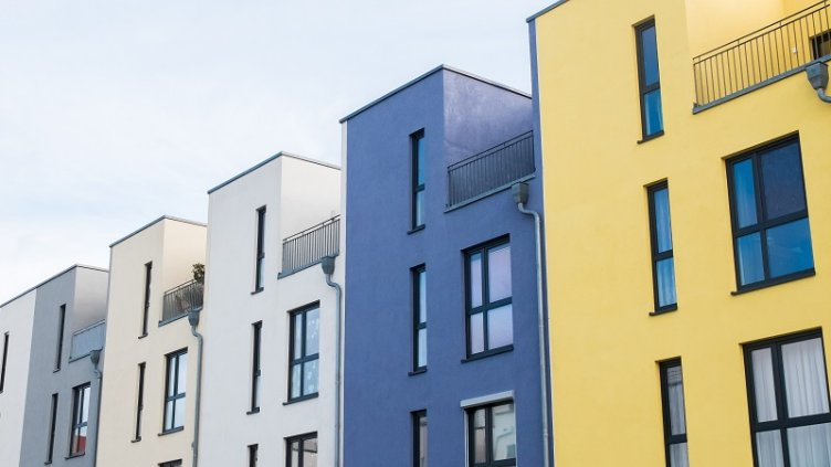 Low Angle Architectural Exterior Detail of Colorful Modern Row Townhouses with Rooftop Patios, Angled in front of Cloudy Blue Sky; Shutterstock ID 361768661; PO: GBLMKT/2016-160; project code: GMKT_BRD_3.9.2E; department code: 162800-Global Marketing